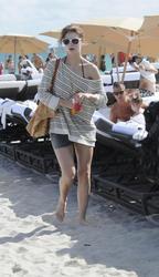 http://img264.imagevenue.com/loc138/th_312487479_Mischa_Barton_Bikini_Candids_on_the_Beach_in_Miami_December_27_2011_195_122_138lo.jpg