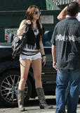 Miley Cyrus leggy in boots and shorts at a studio in Burbank -