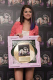 th 63120 SelenaGomezacceptsagoldrecordforheralbumWhenTheSunG 0008 123 429lo Selena Gomez   Receives gold record for When The Sun Goes Down, Four Seasons Hotel, Jan. 26, 2012